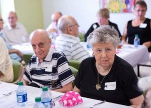 Charlie Gilman, resident for 19 years at Two Victory Road Apartments and eleven year resident Barbara Quealy enjoy the festivities at the Opening Party of the Community Room at Two Victory Road Apartments.